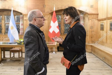 Swiss Federal Councillor, Federal Department of the Environment, Transport, Energy and Communications Doris Leuthard (R) and Ambassador Jorge Marcelo Faurie (L), Minister of Foreign Affairs and Worship of Argentina, chat before signing a memorandum of understanding regarding further cooperation in the railway sector, on the sideline of the 48th annual meeting of the World Economic Forum, WEF, in Davos, Switzerland, 24 January 2018. The meeting brings together entrepreneurs, scientists, corporate and political leaders in Davos, from 23 to 26 January.