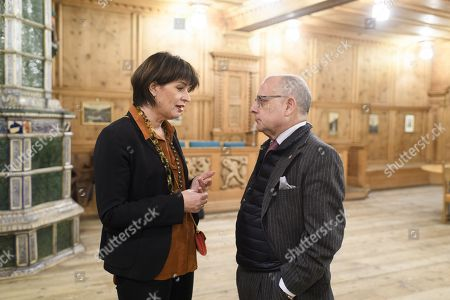 Swiss Federal Councillor, Federal Department of the Environment, Transport, Energy and Communications Doris Leuthard (L) and Ambassador Jorge Marcelo Faurie (R), Minister of Foreign Affairs and Worship of Argentina, chat before signing a memorandum of understanding regarding further cooperation in the railway sector, on the sideline of the 48th annual meeting of the World Economic Forum, WEF, in Davos, Switzerland, 24 January 2018. The meeting brings together entrepreneurs, scientists, corporate and political leaders in Davos, from 23 to 26 January.