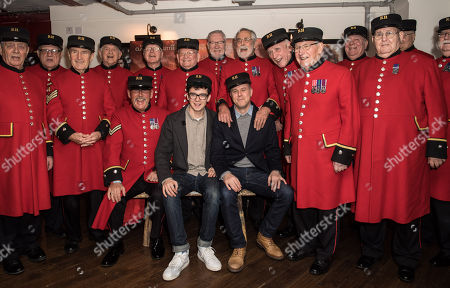 Stock Image of Asa Butterfield and Saul Dibb with Chelsea Pensioners