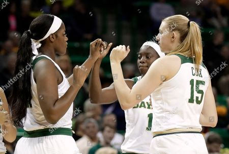 Baylor center Kalani Brown (21), forward Lauren Cox (15) and Dekeiya Cohen (1) greet each other on the court at the start of an NCAA college basketball game against Kansas State in Waco, Texas