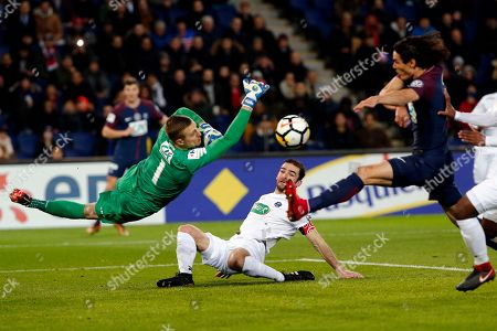 PSG's Edinson Cavani, right, and Guingamp's goalkeeper Karl Johan Johnsson, left, challenges for the ball during the French Cup soccer match, between Paris Saint-Germain and Guingamp at the Parc des Princes Stadium, in Paris, France