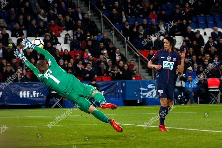 Guingamp's goalkeeper Karl Johan Johnsson, left, blocks the headball of PSG's Edinson Cavan, right, during the French Cup soccer match, between Paris Saint-Germain and Guingamp at the Parc des Princes Stadium, in Paris, France