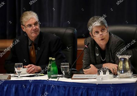 University of California President Janet Napolitano, right, speaks next to State Superintendent of Public Instruction Tom Torlakson during a meeting of the University of California Board of Regents in San Francisco, . Students and other critics who say the cost of education is already too high urged the University of California on Wednesday to reject a proposal that would raise tuition at its campuses for the second consecutive year