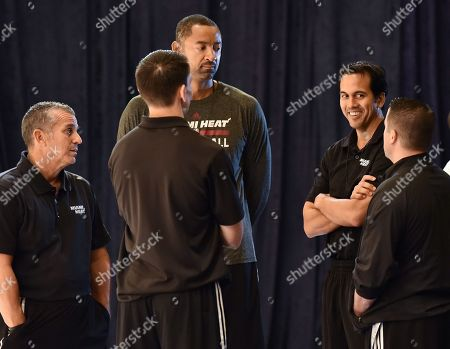 Stock Photo of In this photo provided by the Bahamas Ministry of Tourism, Miami Heat head coach Erik Spoelstra, second from right, talks to his coaching team during the team's training camp in Nassau, Bahamas . The team arrived in the Bahamas on Monday for a week-long training session at the Atlantis, Paradise Island resort