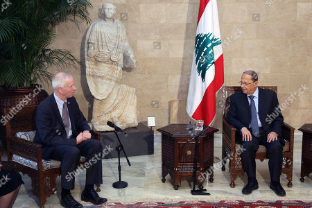 In this photo released by Lebanon's official government photographer Dalati Nohra, Lebanese President Michel Aoun, right, meets with Canadian Foreign Minister Stephane Dion, at the Presidential Palace in Baabda, east of Beirut, Lebanon