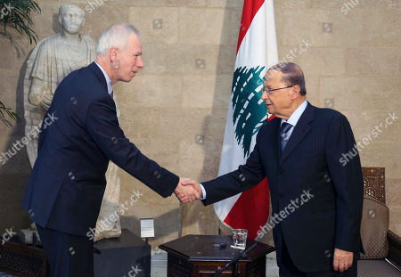 In this photo released by Lebanon's official government photographer Dalati Nohra, Lebanese President Michel Aoun, right, shakes hands with Canadian Foreign Minister Stephane Dion, at the Presidential Palace in Baabda, east of Beirut, Lebanon