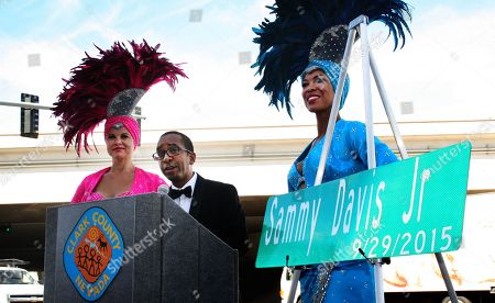This photo provided by Erik Pappa, Clark County communication director, shows Manny Davis son of Sammy Davis Jr. talks during a dedication ceremony to rename a street in his father's name in Las Vegas, . The ceremony was held at the three-way intersection where Sammy Davis Jr. Drive, Frank Sinatra Drive and Dean Martin Drive meet