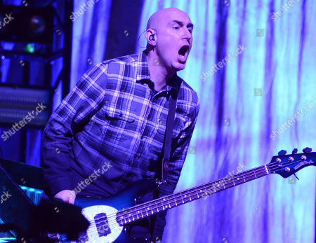 Bassist Aaron Bruch of the band Breaking Benjamin performs at the Resch Center in Green Bay, Wisconsin