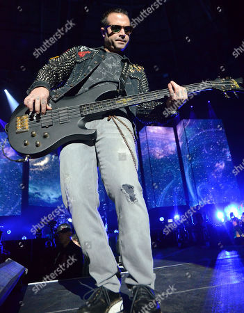 Bassist Johnny Christ of the band Avenged Sevenfold performs at the Resch Center in Green Bay, Wisconsin