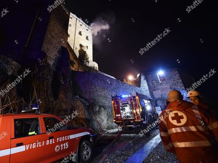 Firemen work to extinguish a fire at the religious complex of Sacra di San Michele (Saint Michael's Abbey), near Turin, northern Italy, 25 January 2018. Emergency service worked overnight to put out the blaze, which reportedly started in the roof of the monastery. According to reports, a short circuit, in the area where renovation works are being carried out, was believed to be the cause of the incident. The Sacra of San Michele was built between 983 and 987, on Mount Pirchiriano, some 40km from Turin. The monument, a symbol of the Piedmont Region, inspired Italian writer Umberto Eco for the novel 'The Name of the Rose' (Il nome della rosa).