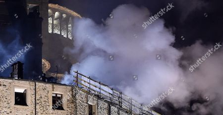 Smoke comes out from the religious complex of Sacra di San Michele (Saint Michael's Abbey), near Turin, northern Italy, 25 January 2018. Emergency service worked overnight to put out the blaze, which reportedly started in the roof of the monastery. According to reports, a short circuit, in the area where renovation works are being carried out, was believed to be the cause of the incident. The Sacra of San Michele was built between 983 and 987, on Mount Pirchiriano, some 40km from Turin. The monument, a symbol of the Piedmont Region, inspired Italian writer Umberto Eco for the novel 'The Name of the Rose' (Il nome della rosa).