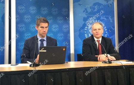 Alejandro Werner, right, director of the Western Hemisphere Department at the International Monetary Fund, holds a press conference with Raphael Anspach, IMF Senior Communications Officer, at the IMF headquarters in Washington, on