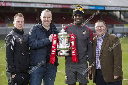 Newport County Manager Michael Flynn, poet Sean Edwards, player Frank Nouble and Chairman Gavin Foxall with the trophy.