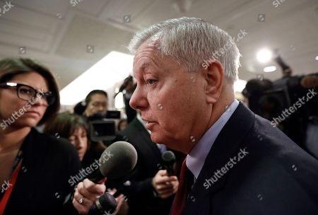 Sen. Lindsey Graham, R-S.C., speaks to reporters as he arrives at the office of Sen. Susan Collins, R-Maine, who is moderating bipartisan negotiations on immigration, at the Capitol in Washington