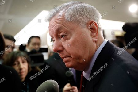 Sen. Lindsey Graham, R-S.C., speaks to reporters as he leaves the office of Sen. Susan Collins, R-Maine, who is moderating bipartisan negotiations on immigration, at the Capitol in Washington, . President Donald Trump has given Congress until March to come up with a plan to protect the nearly 700,000 young people who had been protected from deportation and given the right to work legally in the country under the Obama-era Deferred Action for Childhood Arrivals program, or DACA. Trump announced he was ending DACA last year