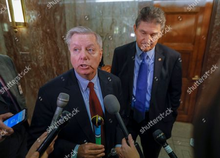 Lindsey Graham, Joe Manchin. Sen. Lindsey Graham, R-S.C., left, and Sen. Joe Manchin, D-W.Va., arrive at the office of Sen. Susan Collins, R-Maine, who is moderating bipartisan negotiations on immigration, at the Capitol in Washington