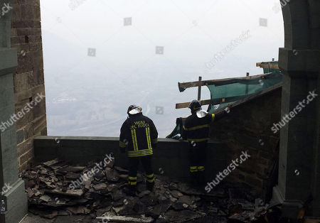 Firemen inspect the roof after a fire at the religious complex of Sacra di San Michele (Saint Michael's Abbey), near Turin, northern Italy, 25 January 2018. Emergency service worked overnight to put out the blaze, which reportedly started in the roof of the monastery. The Sacra of San Michele was built between 983 and 987, on Mount Pirchiriano, some 40km from Turin. The monument, a symbol of the Piedmont Region, inspired Italian writer Umberto Eco for the novel 'The Name of the Rose' (Il nome della rosa).  ANSA/IRENE FAMA'