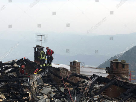 Firemen inspect the roof after a fire at the religious complex of Sacra di San Michele (Saint Michael's Abbey), near Turin, northern Italy, 25 January 2018. Emergency service worked overnight to put out the blaze, which reportedly started in the roof of the monastery. The Sacra of San Michele was built between 983 and 987, on Mount Pirchiriano, some 40km from Turin. The monument, a symbol of the Piedmont Region, inspired Italian writer Umberto Eco for the novel 'The Name of the Rose' (Il nome della rosa). 