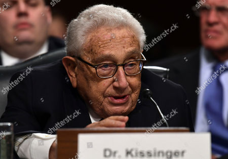 Former Secretary of State Henry Kissinger speaks during the Senate Armed Services Committee hearing on Capitol Hill in Washington, on global challenges and U.S. national security strategy. Kissinger testified at the hearing along with former Secretary of State George Shultz and former Deputy Secretary of State Richard Armitage