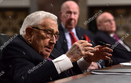 Henry Kissinger, George Shultz, Richard Armitage. Former Secretary of State Henry Kissinger, left, speaks during the Senate Armed Services Committee hearing on Capitol Hill in Washington, on global challenges and U.S. national security strategy. Kissinger testified at the hearing along with former Secretary of State George Shultz, center, and former Deputy Secretary of State Richard Armitage, right