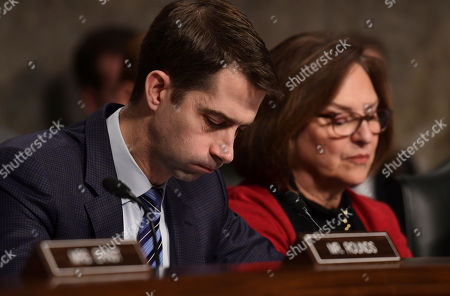 Tom Cotton, Deb Fischer. Sen. Tom Cotton, R-Ark., left, and Sen. Deb Fischer, R-Neb., right, listen to testimony during a Senate Armed Services Committee hearing on Capitol Hill in Washington, on global challenges and U.S. national security strategy. The witnesses were former Secretary of State Henry Kissinger, former Secretary of State George Shultz and former Deputy Secretary of State Richard Armitage