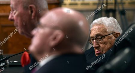 Henry Kissinger, George Shultz, Richard Armitage. Former Secretary of State Henry Kissinger, right, listens during the Senate Armed Services Committee hearing on Capitol Hill in Washington, on global challenges and U.S. national security strategy. Kissinger testified at the hearing along with former Secretary of State George Shultz, left, and former Deputy Secretary of State Richard Armitage, center