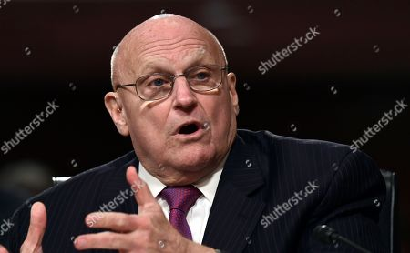 Stock Image of Former Deputy Secretary of State Richard Armitage speaks during the Senate Armed Services Committee hearing on Capitol Hill in Washington, on global challenges and U.S. national security strategy. Armitage testified at the hearing along with former Secretary of State Henry Kissinger and former Secretary of State George Shultz