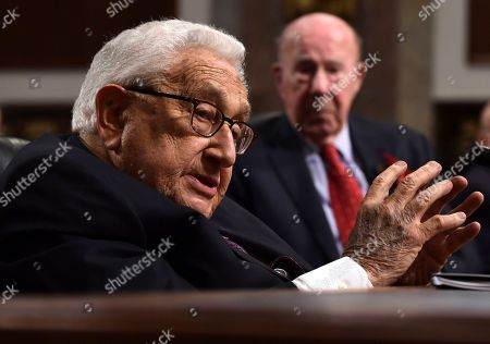 Stock Photo of Henry Kissinger, George Shultz. Former Secretary of State Henry Kissinger, left, speaks during the Senate Armed Services Committee hearing on Capitol Hill in Washington, on global challenges and U.S. national security strategy. Kissinger testified at the hearing along with former Secretary of State George Shultz, right, and former Deputy Secretary of State Richard Armitage