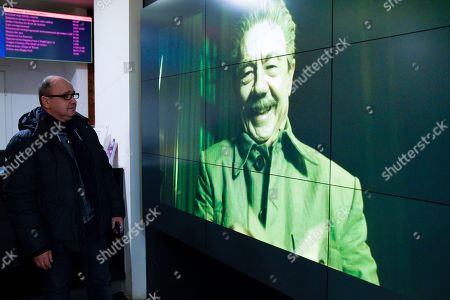 Stock Image of A screen in Pioner movie theater shows an episode with actor Adrian McLoughlin as Soviet leader Josef Stalin, from the Death of Stalin film, in Moscow, Russia, . A Moscow movie theater has shown a satirical film about Soviet leader Josef Stalin despite an official ban