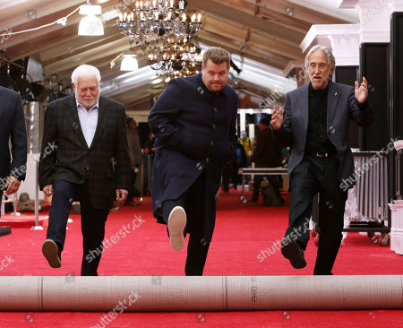 Jack Sussman, Ken Ehrlich, James Corden, Neil Portnow. Producer Ken Ehrlich, from left, Grammys host James Corden, and president of The Recording Academy Neil Portnow participate in the 60th annual Grammy Awards red carpet roll out at Madison Square Garden, in New York. The 60th grammy Awards will be held on Sunday