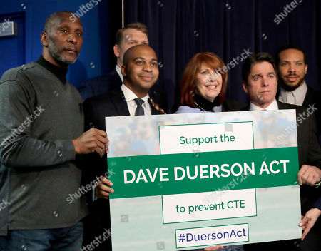 Mike Adamle, Carol Sente, Mike Adamle, Otis Wilson. From left, Former Chicago Bears linebacker Otis Wilson, Tregg Duerson, Illinois state Rep. Carol Sente, D-Vernon Hills, and former Chicago Bears' Mike Adamle pose for a photo after a news conference in support of the Dave Duerson Act to Prevent CTE, in Chicago. The Dave Duerson Act is named for the Chicago Bears defensive back who was diagnosed with chronic traumatic encephalopathy after he killed himself at the age of 50, would ban organized tackle football for Illinois children younger than 12 years old