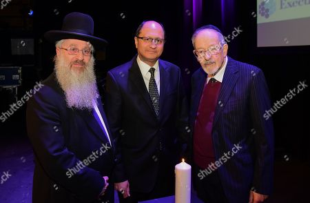 Stock Photo of David Singer Rabbi of Belfast and NI, Shailesh Vara MP (Patliamentary Under-secretary of Northern Ireland) and Dr Martin Stern MBE after the Northern Ireland regional Holocaust Memorial event that marked the 73rd anniversary of the liberation of the Nazi concentration and extermination camp Auschwitz-Birkenau.