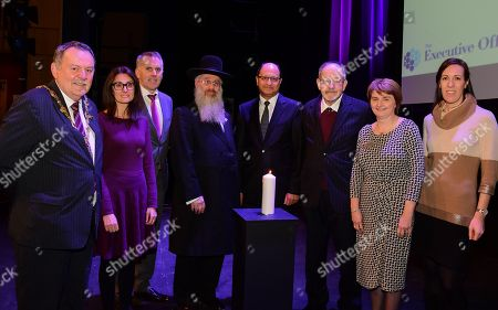 Stock Image of Councillor Madíosa McHugh (Mayor of Derry), Lucy Granet, David Sterling, David Singer Rabbi of Belfast and NI, Shailesh Vara MP (Patliamentary Under-secretary of Northern Ireland) and Dr Martin Stern MBE, Shirley Lennon (Holocaust Memorial Trust) and Jane Hurwitz (Formal act of Commemoration), after the Northern Ireland regional Holocaust Memorial event that marked the 73rd anniversary of the liberation of the Nazi concentration and extermination camp Auschwitz-Birkenau.