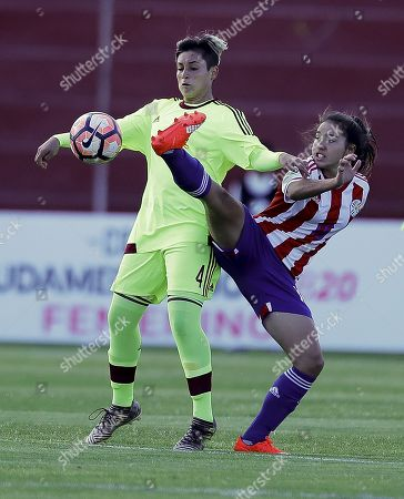 Stock Image of Jessica Sanchez (R) of Paraguay vies for the ball with Sandra Luzardo (L) of Venezuela during their semifinal at Women U-20 South American soccer tournament in Ambato, Ecuador, 25 January 2018.