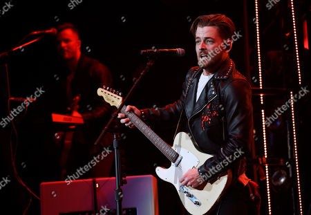 Chase Bryant performs during Brad Paisley's Weekend Warrior World Tour stop at Staples Center, in Los Angeles