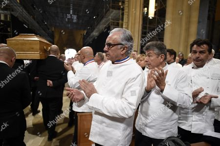 """French chefs Alain Ducasse, Regis Marcon and French chef Yannick Alleno applaud as the coffin French chef Paul Bocuse leaves the Saint-Jean Cathedral in Lyon, France, 26 January 2018. More than 1,500 chefs from around the world along with thousands of fans of French cuisine are expected in Lyon to honor their """"pope"""" Paul Bocuse, who died on 20 January 20 aged 91."""