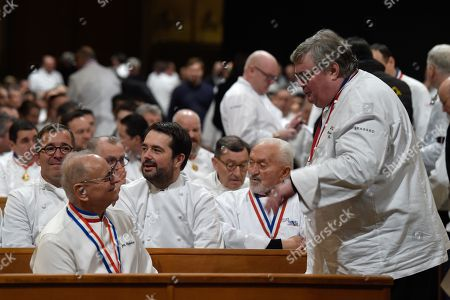 "French chef Joel Robuchon (L) and Jean-Francois Piege (3-L) attend the funeral ceremony for French chef Paul Bocuse at the Saint Jean Cathedral in Lyon, France, 26 January 2018. More than 1,500 chefs from around the world along with thousands of fans of French cuisine are expected in Lyon to honor their ""pope"" Paul Bocuse, who died on 20 January 20 aged 91."