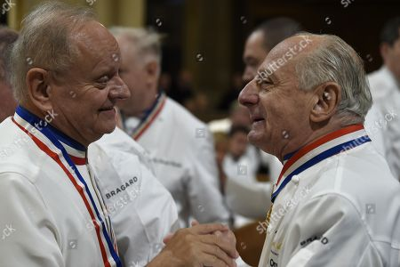 """French chefs Joel Robuchon (L) and Pierre Orsi talks upon their arrival to attend the funeral ceremony for French Paul Bocuse at the Saint-Jean Cathedral in Lyon, France, 26 January 2018. More than 1,500 chefs from around the world along with thousands of fans of French cuisine are expected in Lyon to honor their """"pope"""" Paul Bocuse, who died on 20 January 20 aged 91."""