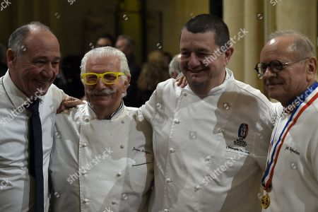 """(L-R) French chefs Marc Haeberlin, Jacques Marguin, Chritsophe Marguin and French chef Joel Robuchon attend the funeral ceremony for French Paul Bocuse at the Saint-Jean Cathedral in Lyon, France, 26 January 2018. More than 1,500 chefs from around the world along with thousands of fans of French cuisine are expected in Lyon to honor their """"pope"""" Paul Bocuse, who died on 20 January 20 aged 91."""