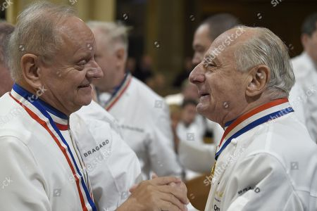 French chefs Joel Robuchon, left, and Pierre Orsi attend the funeral ceremony for late French chef Paul Bocuse at the Saint-Jean cathedral, in Lyon, central France, . Hundreds of chefs and French dignitaries are gathering in the culinary mecca of Lyon for the funeral of Paul Bocuse, a master chef who defined French cuisine for more than a half-century and put it on tables around the world