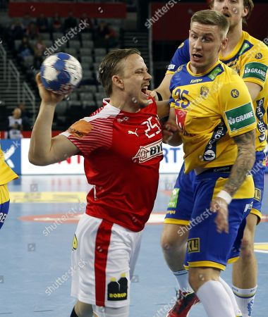 Morten Olsen (L) of Denmark in action against Jesper Nielsen Linus Arnesson (R) of Sweden, during the semi final match between Denmark and Sweden for the Mens Handball European Championship 2018 in Zagreb, Croatia, 26 January 2018.