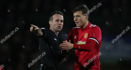 Referee, Paul Tierney has words with Victor Lindelof of Manchester United after the foul on Sam Surridge of Yeovil Town during the FA Cup Fourth Round Match between Yeovil Town and Manchester United at Huish Park, Yeovil, Somerset, on January 26th 2018