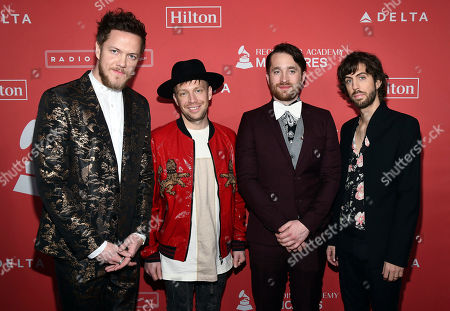 Dan Reynolds, Ben McKee, Daniel Platzman, Daniel Wayne Sermon. Dan Reynolds, from left, Ben McKee, Daniel Platzman and Daniel Wayne Sermon of Imagine Dragons arrives at the 2018 MusiCares Person of the Year tribute honoring Fleetwood Mac at the Radio City Music Hall on in New York