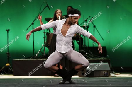 Stock Image of Colombian dancer Fernando Montano, soloist of the Royal Ballet of London, performs while accompanied by the band Suricato during the presentation 'Art changes the world' during the second day of the Hay Festival in Cartagena, Colombia, 26 January 2018.