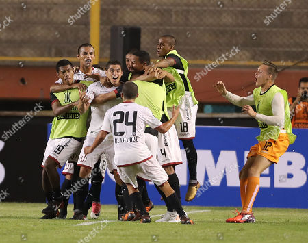 Universitario de Deportes' defense Aldo Corzo celebrates with his teammates after scoring against Oriente Petrolero during a phase one match of the Libertadores Cup in Lima, Peru, 26 January 2018.