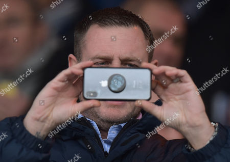 Peterborough United Chairman Darragh MacAnthony videos the sell-out crowd