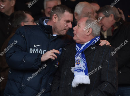 Director of Football Barry Fry looks shocked as Peterborough United Chairman Darragh MacAnthony leans into him to talk