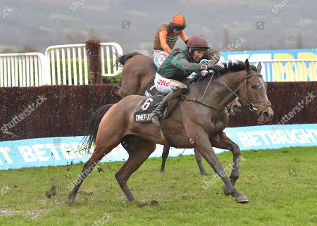 (No 6) Mr Whitaker (Adrian Heskin) takes the last before going on to win The Timeform Novices Handicap Steeple Chase from Theatre Territory (Sam Waley-Cohen).