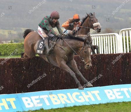 (L) Mr Whitaker (Adrian Heskin) takes the last before going on to win The Timeform Novices Handicap Steeple Chase from (R) Theatre Territory (Sam Waley-Cohen).