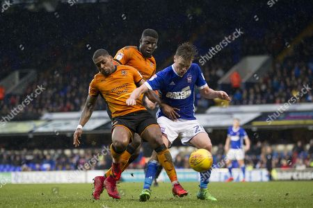 Stephen Gleeson of Ipswich Town outmuscles Alfred N'Diaye and Ivan Cavaleiro of Wolverhampton Wanderers during Ipswich Town vs Wolverhampton Wanderers, Sky Bet EFL Championship Football at Portman Road on 27th January 2018